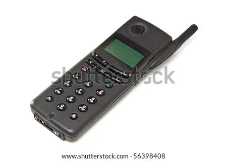 Old black cell phone isolated on the white background. - stock photo