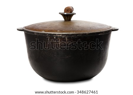 Old black dirty pot isolated on white background - stock photo