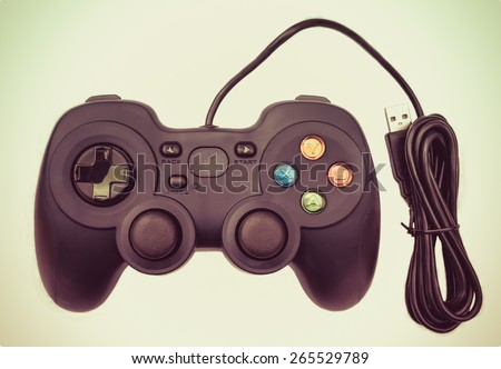 Old black joystick for console video game in isolated background in retro color - stock photo