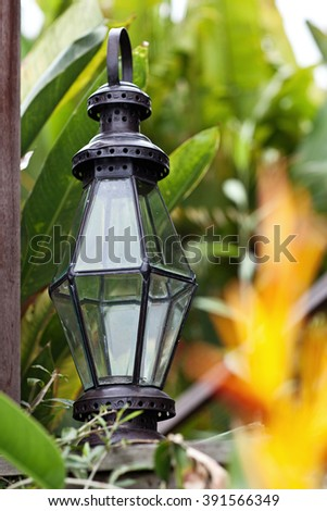 Old black metal vintage lamps in grey exterior. Outside decor