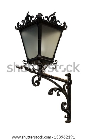Old black metal wall streetlight isolated on white - stock photo