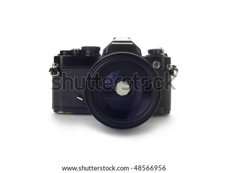 old black 35mm SLR camera - stock photo