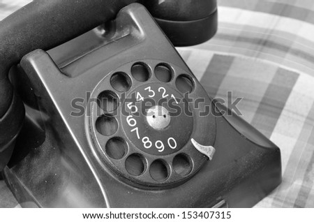 Old black phone in black and white,vintage style - stock photo