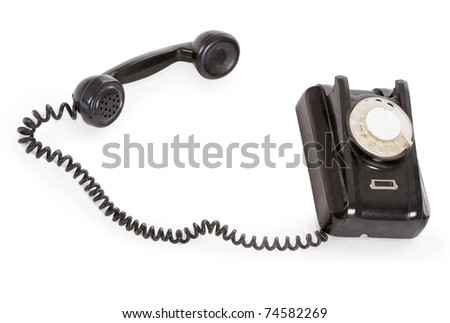 old black phone isolated over white - stock photo