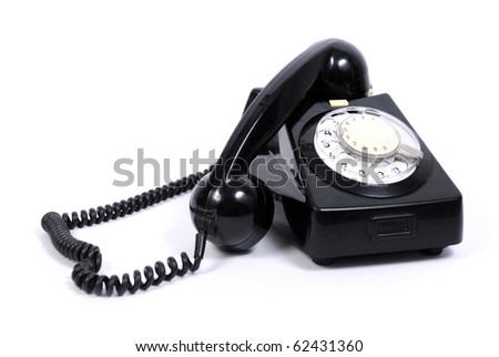 Old black phone on white background - stock photo