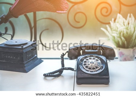 Old black phone with dust and scratches, retro style concept  - stock photo