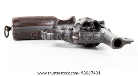 old black pistol close-up isolated on white background - stock photo