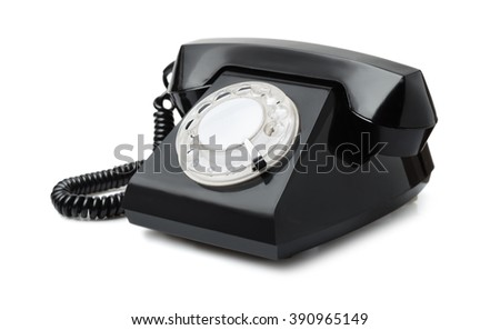 Old black rotary phone isolated on white - stock photo