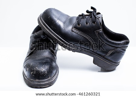 Old black safety shoes