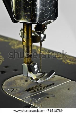 Old black sewing machine on white background - stock photo