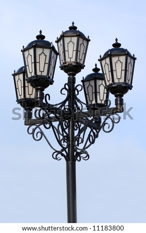 old black street lamp under blue sky - stock photo