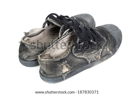 Old black Thai student sneakers on white isolated.