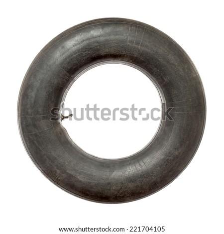 Old black tire tube isolated on white - stock photo