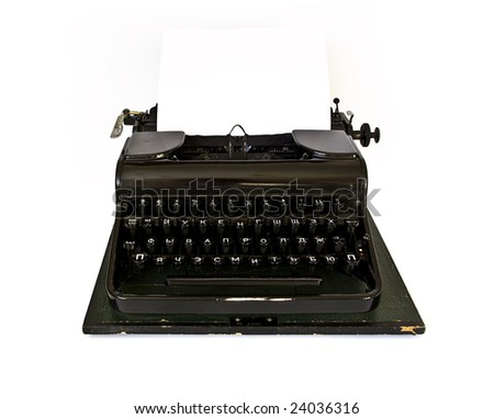 Old black typewriter isolated on white background