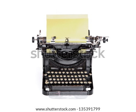 Old black typewriter, keyboard and writing paper