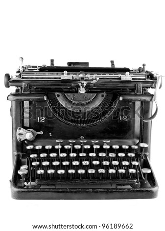 Old black typewriter on a white background - stock photo