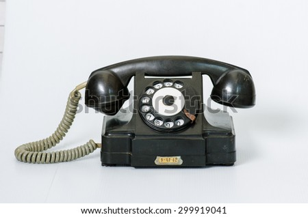 old black vintage phone isolated  - stock photo