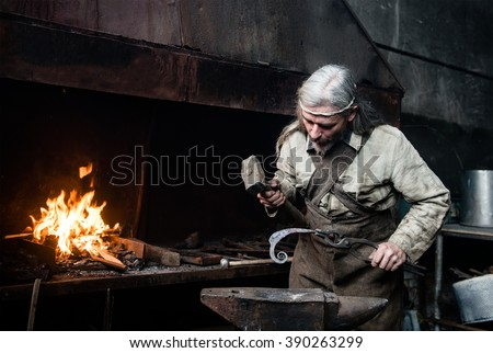 Old blacksmith forge forges metal products - stock photo