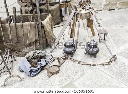 Old blacksmith tools, detail work iron utensils - stock photo