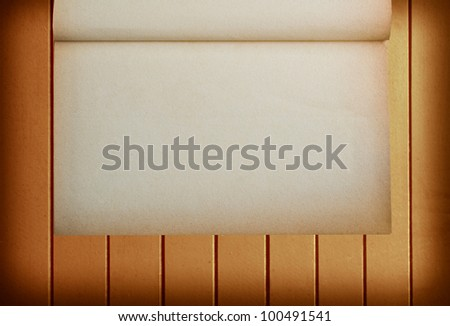 Old blank paper on wood background