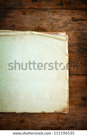Old blank paper on wooden background - stock photo