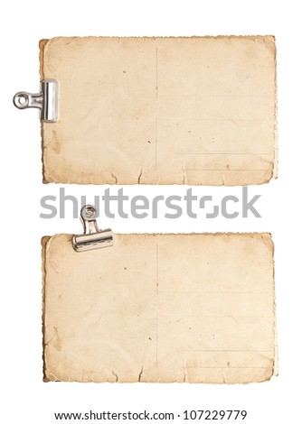 old blank paper photo sheets with clip isolated on white background - stock photo