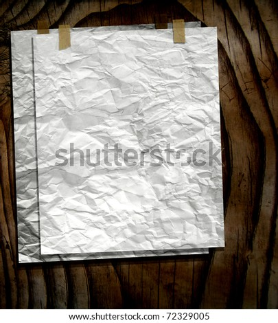 Old Blank Papers Taped On Wood Wall - stock photo