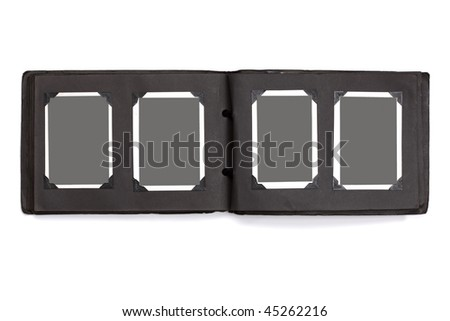 Old blank pictures with black corners in a photograph album ready for photos - stock photo