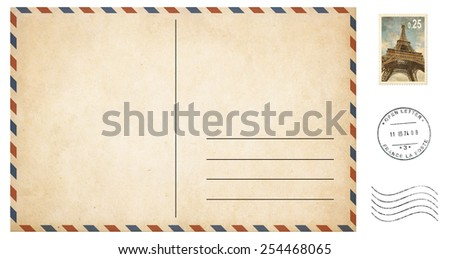 old blank postcard isolated on white with post stamps set - stock photo