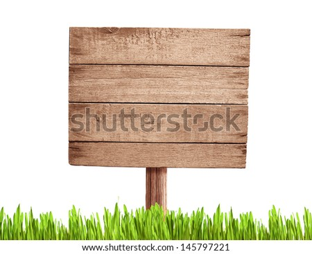 old blank wood road sign with grass - stock photo
