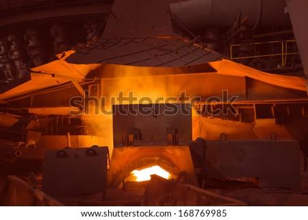 Old blast iron smelting furnace - stock photo