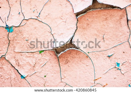 old blue and pink paint texture closeup. blue  and pink cracked and peeling paint background with texture. Peeling paint on wall seamless texture. Pattern of rustic blue grunge material.