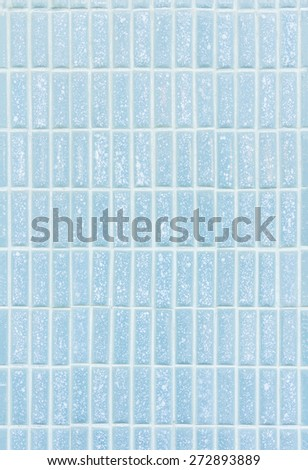 Old blue color tone rectangle ceramic tile with filling wall texture background - stock photo