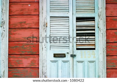 Old Blue door in the suburbs of New Orleans. - stock photo