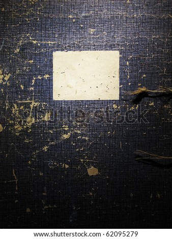 Old blue drawing portfolio with a nameplate - stock photo