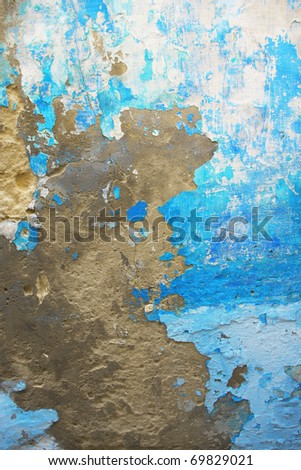 Old blue grungy wall texture. Peeling stained surface background. - stock photo