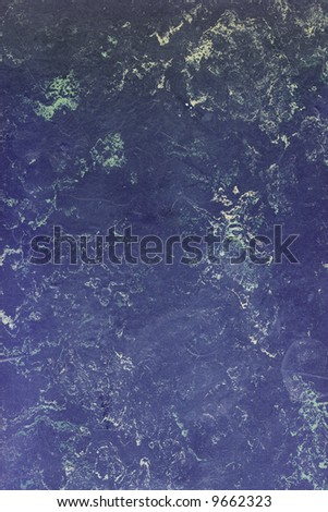 Old blue marbled linoleum, suitable as a background texture. - stock photo