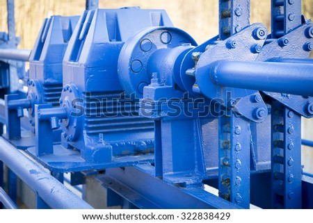 Old blue mechanism of flood gate
