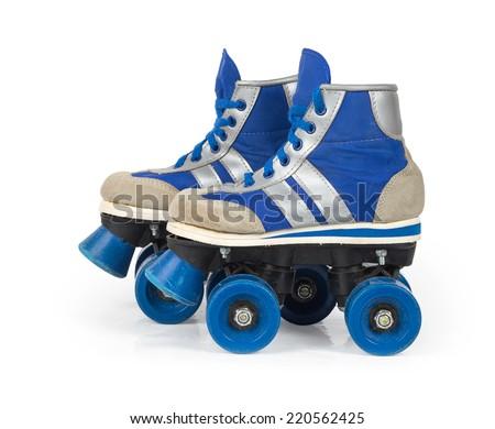 Old blue roller skates isolated on white background - stock photo
