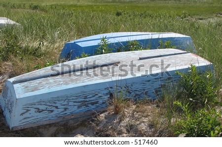 old blue row boats on Cape Cod - stock photo