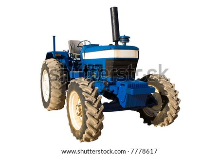 old blue rusty tractor with dirty wheels - stock photo