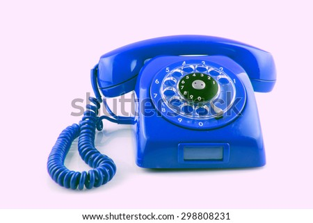 old  BLue telephone with rotary dial color toned - stock photo