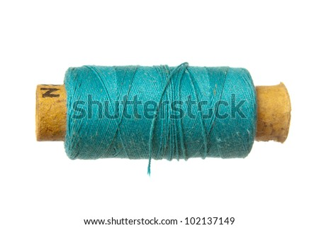 Old blue threads spool isolated on white - stock photo