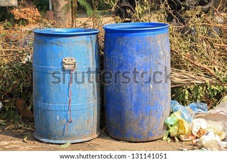 Old blue trash - stock photo