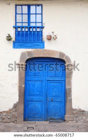 Old, blue, wood door and window. Cuzco, Peru. - stock photo