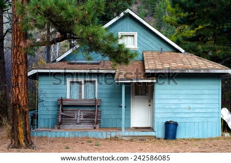 Old blue wood siding house: summer cottage in Tulameen, BC ghost-town - stock photo