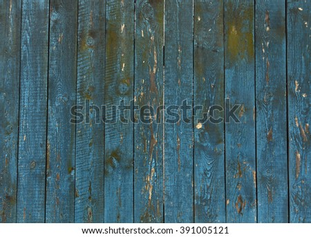 Old blue wooden fence texture. Architectural background and texture for design. - stock photo