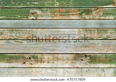 old board with peeling paint green