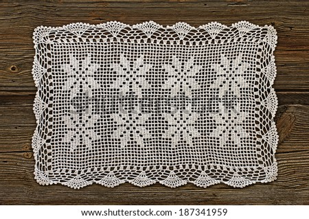 Old boards covered with handmade crocheted doily