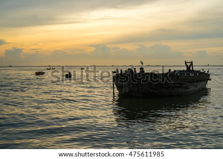 old boat and sunset view